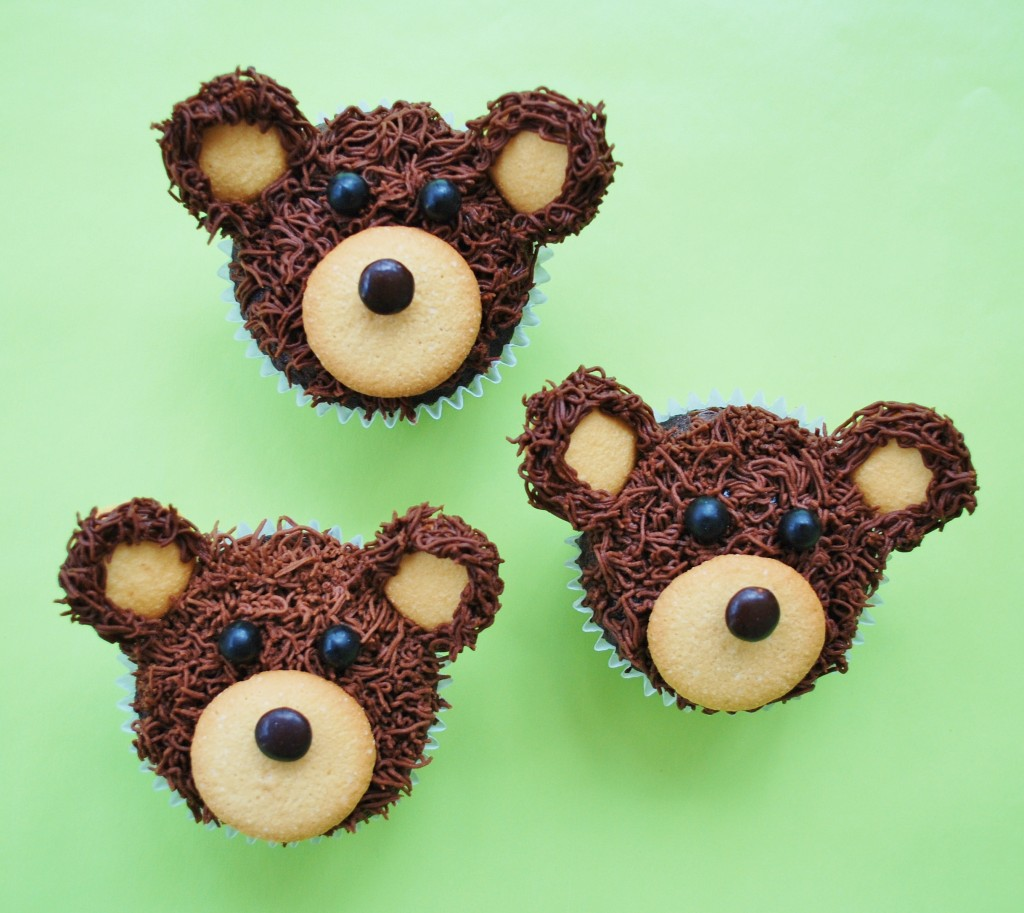 These bear cupcakes are a cute idea for a camping excursion or an animal-themed party. They are very easy to make, topped with premade wafer cookies and candies.