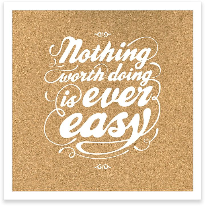 "Be inspired each day with the ""Nothing Worth Doing is Ever Easy"" Framed Corkboard."